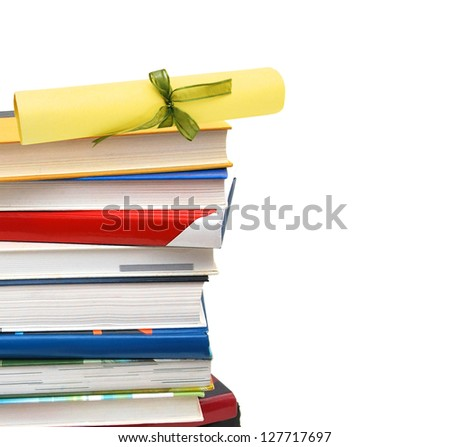 A diploma over  books. Isolated on white.
