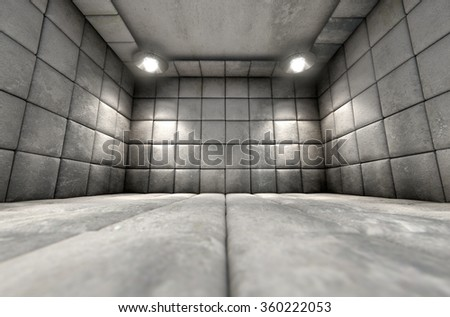 A dirty white padded cell in a mental hospital