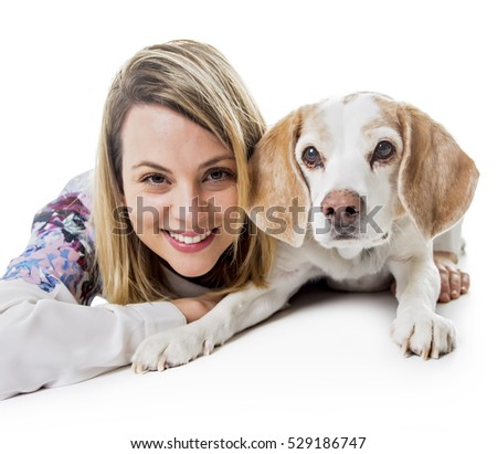 A Dog with woman are posing in studio - isolated on white background