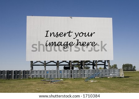 A drive-in movie screen with words.