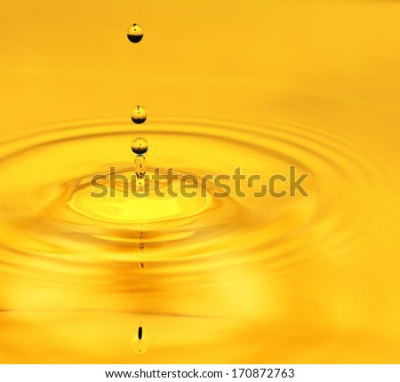 A drop of golden water. macro