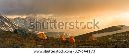 A fantastic sunset during a thunderstorm in a tent camp high in the mountains of Altai