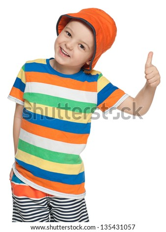 A fashion little boy in panama holds his thumb up; on the white background
