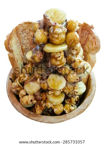 A favorite dessert in summer at Thailand, Fantasy ice with bread banana popcorn caramel cocoa flavored ice on white background