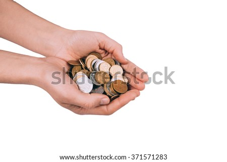 A female hand with coin isolated against a white background