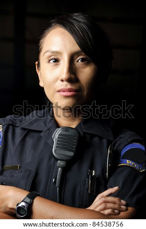 a female police officer posing for her portrait at night.