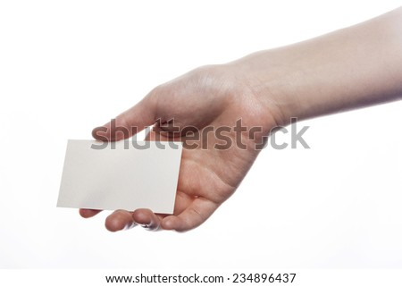 A female(woman) hand hold(pick up) a empty(blank) paper(business name card) isolated white at the studio.
