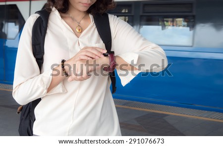 A female(woman) looking at her smart watch