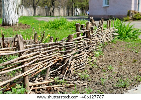 A fence made of wooden branches