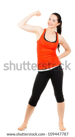 A fit beautiful sporty young woman flexing her muscles. Isolated on white.