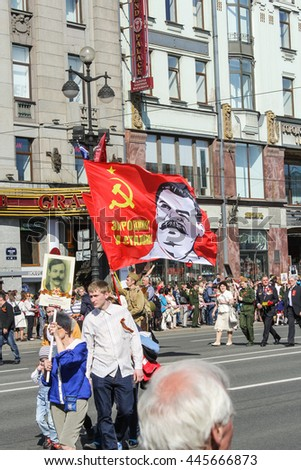 "A flag with a portrait of Stalin. St. Petersburg, Russia - 9 May, 2016. Holiday-action ""Immortal regiment"" taking place in St. Petersburg on Nevsky Prospect."