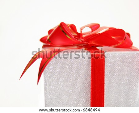 a gift with red ribbon on a white background.