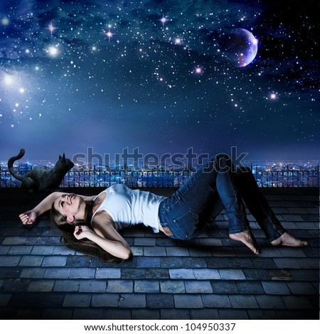 a girl and a cat are lying on a rooftop under the starry sky