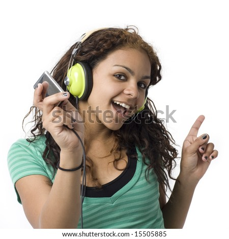 A girl sings along with her headphones and media player