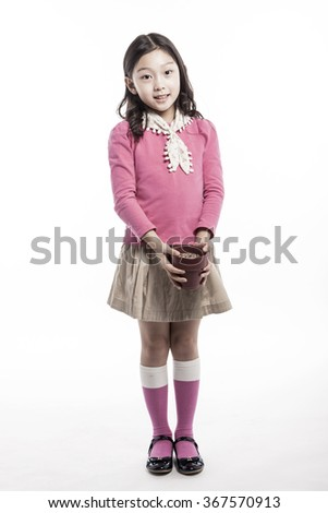 A girls(woman, female) wearing pink blouse and skirt hold a blank(empty) flower pot with smile(happy) isolated white at the studio.