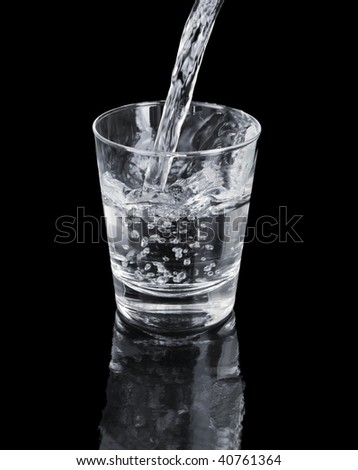 A Glass of clean water on black reflecting backdrop