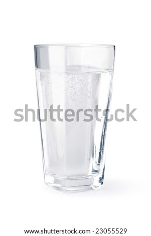 A glass of sparkling mineral water on white background.