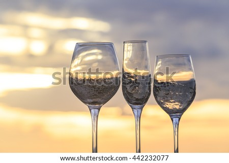 a glass of wine at sunset time