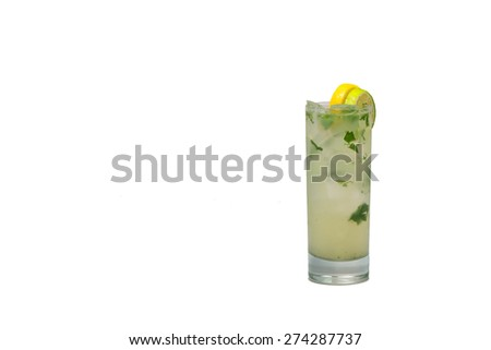 A glass with a mojito drink with condiments