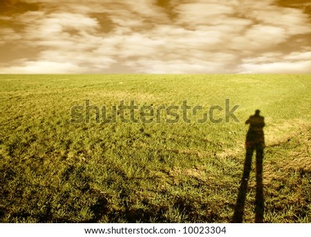 a grassland and a shadow