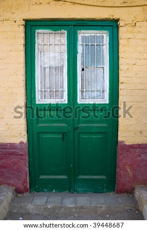 A green old door in the countryside of Egypt