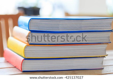 A group of books on wood table