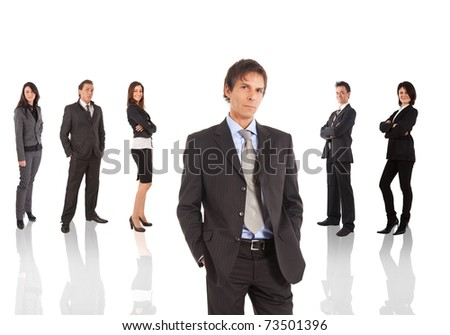 A group of businessmen and businesswomen, their leader is on the front