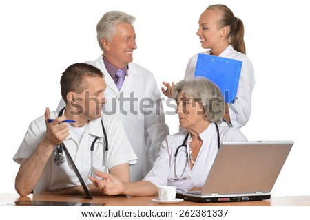 A group of doctors discussing at the table