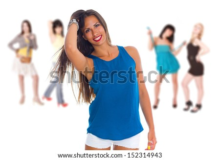 A group of five young women in casual clothing on white background