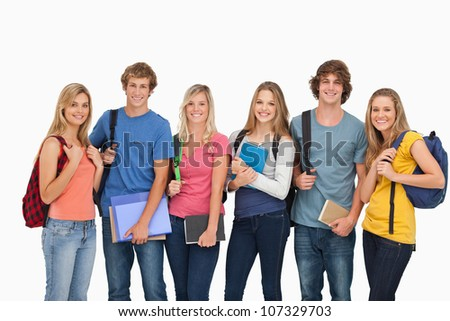 A group of smiling students with the school gear