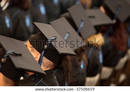 A group of students seated at graduation