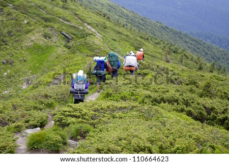 A group of young people go on a mountain path