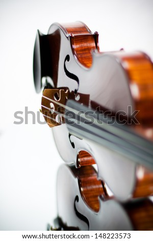A hand crafted violin reflected in a mirror