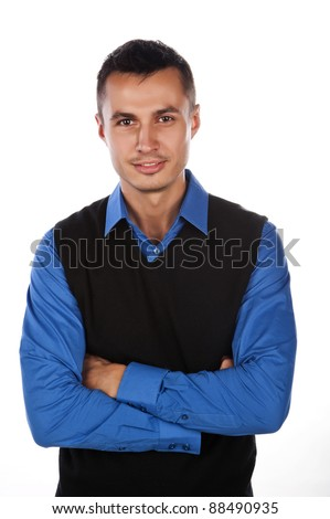 a handsome young man of business in a blue shirt and black vest,isolated over white