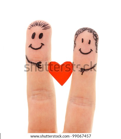 A happy couple in love with painted smiley and hugging isolated on white background