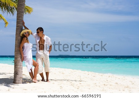 A happy young couple on a beach