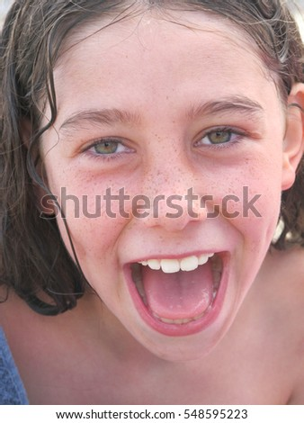 A happy young girl face in close-up