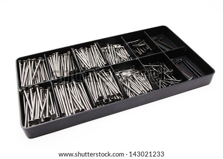 A hardware box with a set of different nails, isolated on white background.