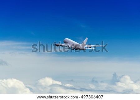 A huge commercial air plane just departure and flying on the blue sky.