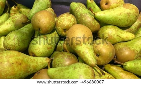 A large bulk bin of pairs at a fresh produce stand, juicy organic sweet green yellow pears background, natural pears background, high quality resolution.
