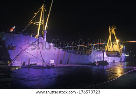 A large cargo ship, the Sao Paolo, lit up at night in a Miami, Florida harbor