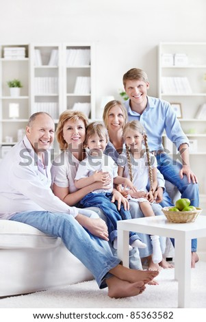 A large family with children and grandchildren at home