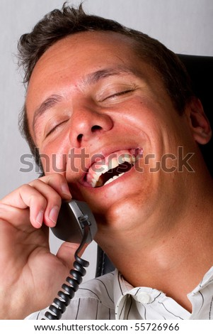 A laughing man on telephone