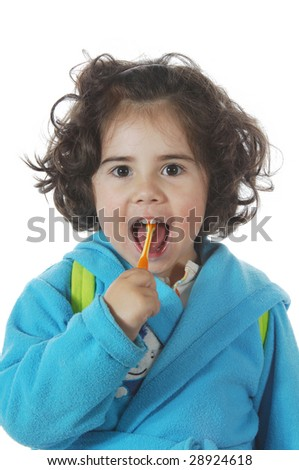 A little cute girl brushing the teeth isolated on white background