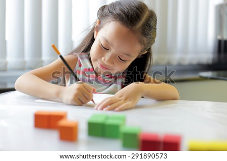 A little girl enjoying her learning at school - copy space available
