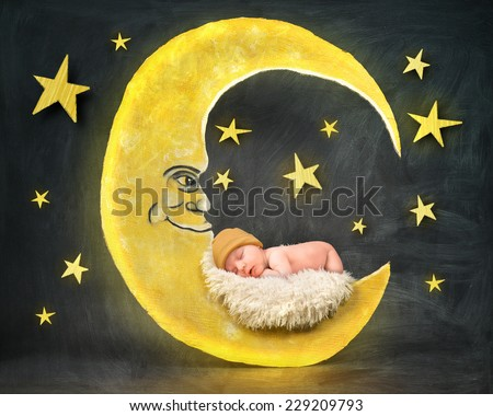 A little newborn baby is sleeping on a paper cutout of a yellow moon with stars in the background for a bedtime or sleep concept.