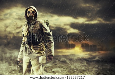 A lonely hero wearing gas mask, city destroyed on the background