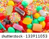 A lot of colorful colorful candies for background - stock photo