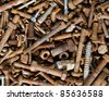 A lot of old rustic screws. Useful for backgrounds. - stock photo