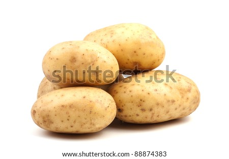 a lot of raw potatoes on a white background